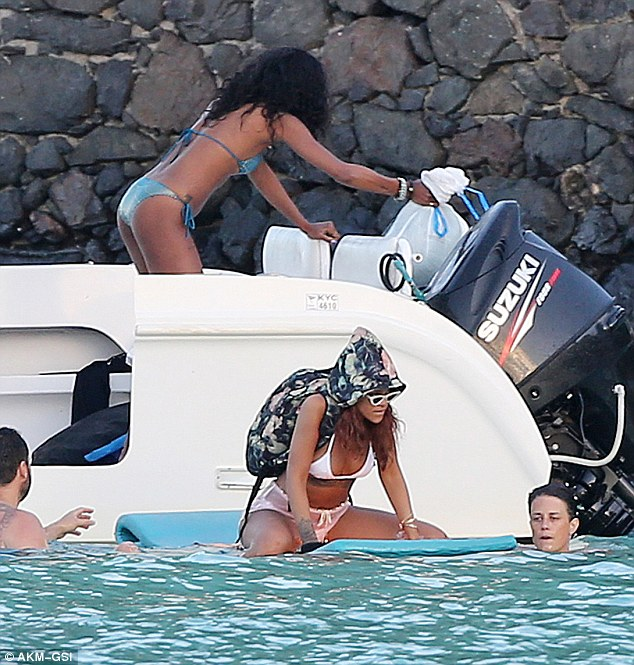 Heading out: Rihanna braved the water on a floating bed