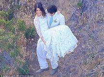 Nikki Reed and Ian Somerhalder kiss as they tie the knot ...