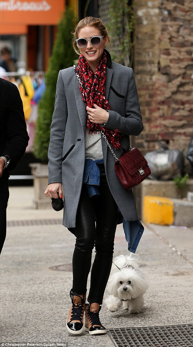 Stepping out in style: Olivia Palermo was spotted leaving Sant Ambreous restaurant in New York City on Sunday with her dog Mr. Butler in tow