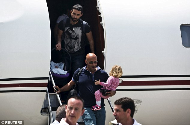 Sunny: An Israeli couple disembark from a military airplane after being flown to Sde Dov airport in Tel Aviv