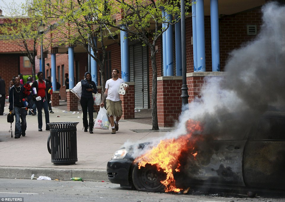 Lawlessness: The riots broke out just a few blocks from the site of the funeral of 25-year-old Freddie Gray in northwest Baltimore and then spread through other parts of the city in the most violent demonstrations since looting in Ferguson, Missouri, last year