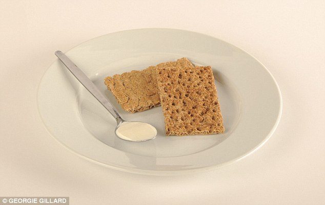 Two rye crispbread with one tablespoon of low fat soft cheese spread make a wholesome 100 calorie snack