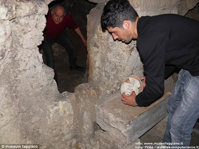 Lucian Faggiano's dream of opening a restaurant was scuppered when a dig to find a blocked sewage point yielded some 2,000 years of hidden history, including vast rooms and pottery (shown in this image that features Mr Faggiano left and his son)