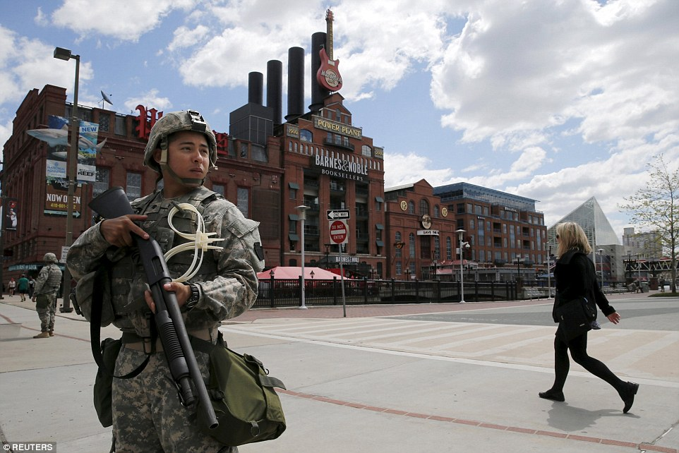 Power: National Guard troops patrol in front of the Power Plant in the Inner Harbor of Baltimore, Maryland, United States after their deployment by Maryland Governor Larry Hogan