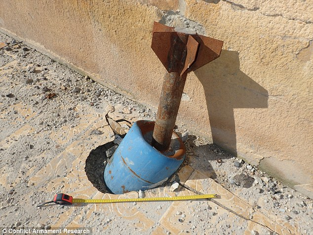 Pictured is one of the IEDs found in Kobane - a rocket welded to a gas canister filled with homemade explosives and metals