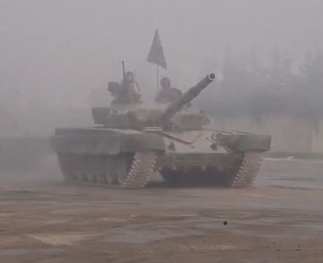Might: Their incredible show of strength in their Damascus stronghold of Ghouta included a fleet of armoured tanks