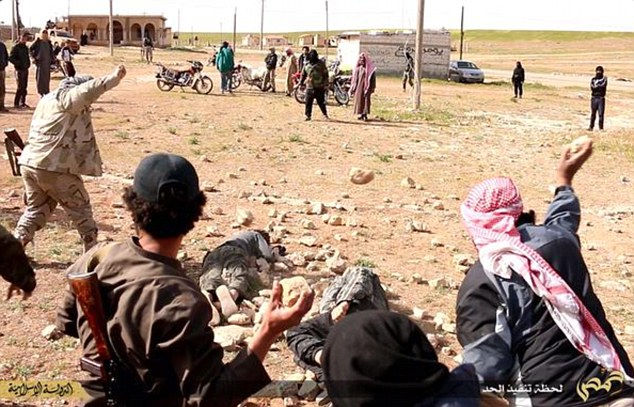 Brutal:The shocking images were taken in ISIS-held territory in the province of Homs recently and show the two accused men being savagely executed by up to four jihadis