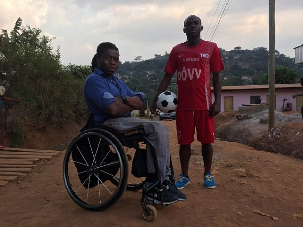 Adepitan with Bati - one of many Cameroonian men desperate for a big break to become a professional footballer and willing to pay a high price to achieve their dream