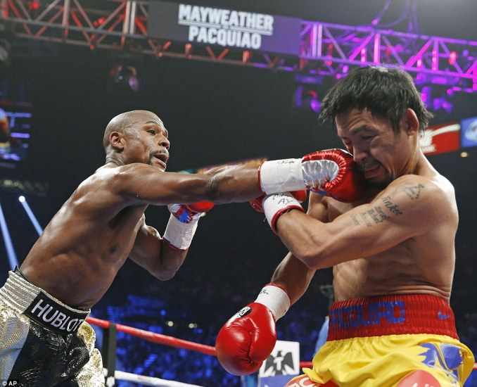 Mayweather makes contact with a straight right - a weapon he kept deploying against Pacquiao