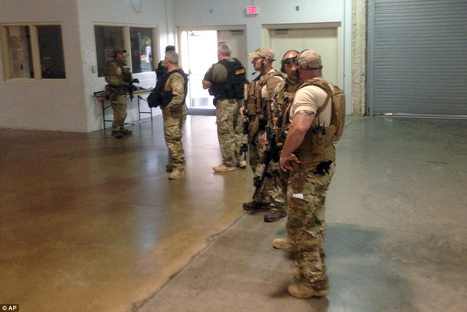 At the ready: Members of the Garland Police Department stand guard inside the Curtis Culwell Center in the aftermath of the shooting