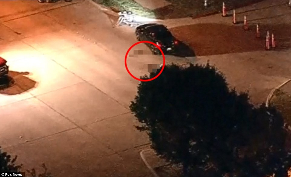 Attack: The suspects' bodies are seen next to their vehicle as it is searched for explosives at the anti-Muslim event. Two men got out the vehicle and opened fire, wounding a security guard in the leg, before they were shot dead by police