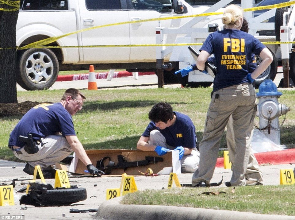 FBI investigators collect evidence, including a rifle, where the men were shot dead; police say they intended to open fire on the venue