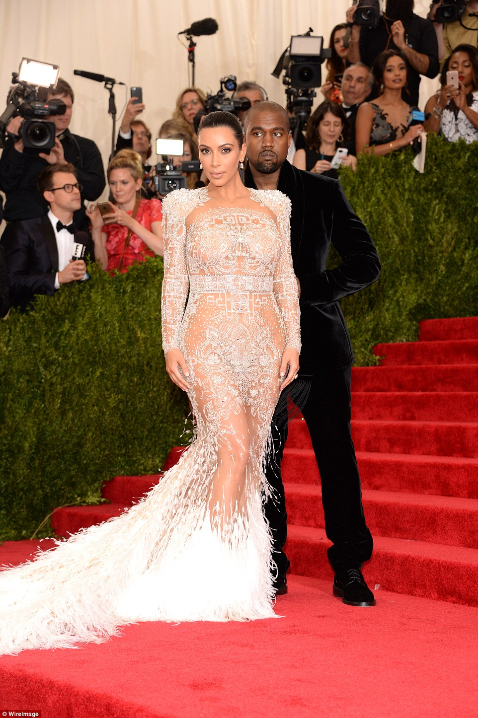 Best assets forward: The 34-year-old displayed her heavenly figure on Monday night at the Anna Wintour hosted event in a sheer lace gown, revealing she had forgone underwear for the evening