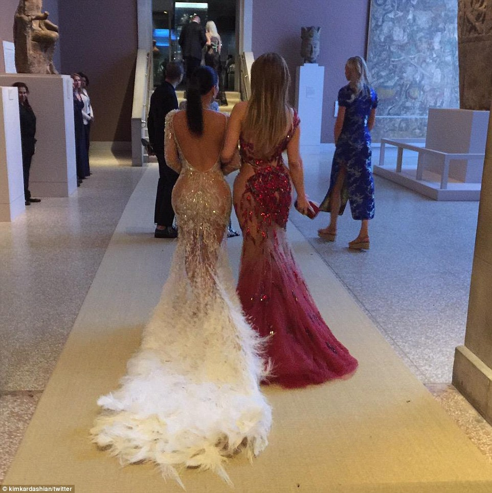 Booty on duty: Kim is seen in this Instagram snap walking with Jennifer Lopez who also left little to the imagination in her daring to bare gown