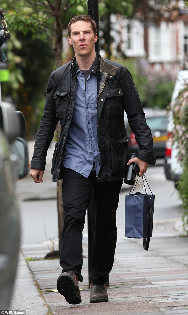 Man on a mission: Benedict Cumberbatch paid a visit to some friends in London on Sunday afternoon
