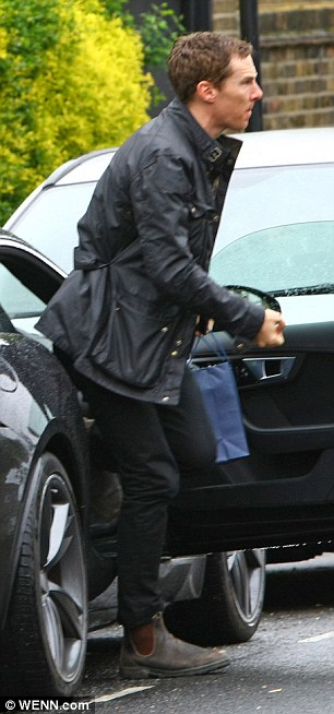 House call: Benedict hopped out of his car, carrying a goodie bag in his hand