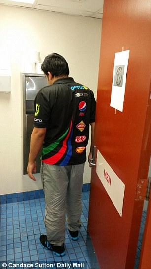 Mohammad Faisal in the men's toilet where the sign is still on the door 'banning' Islamic pre prayer ablutions
