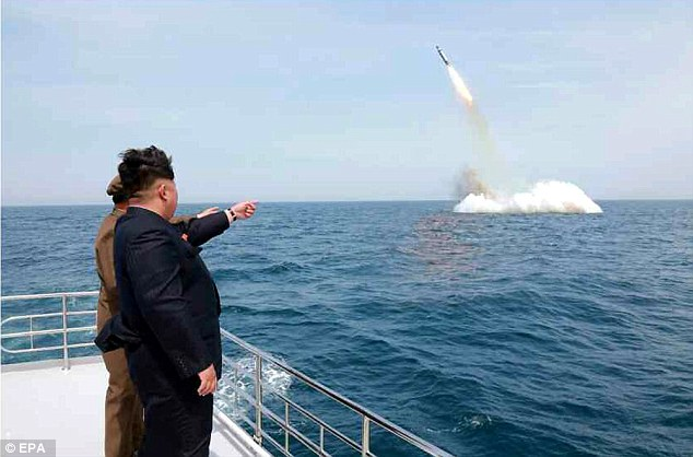 Destruction: Kim (pictured watching the launch) has said his country is now capable of 'striking and wiping out in any waters the hostile forces infringing upon the sovereignty and dignity of [North Korea]'