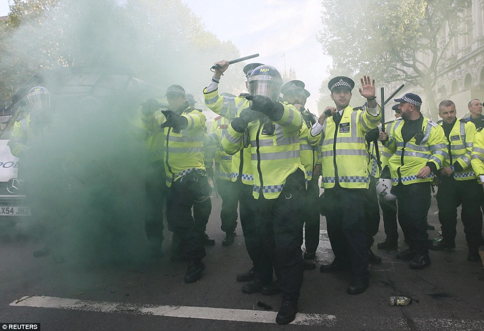 It was reported that smoke bombs, bottles, cans and even a bicycle were hurled at police officers during this afternoon's disturbances