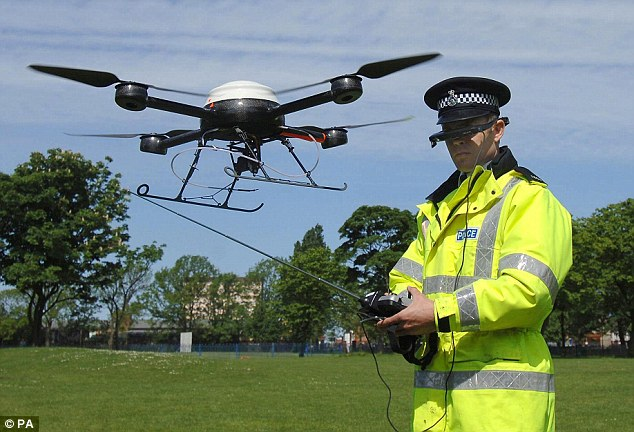 PC Derek Charlton of Merseyside Police operates their new aerial surveillance drone in Liverpool. Officers in Merseyside to track criminals and record anti-social behaviour.