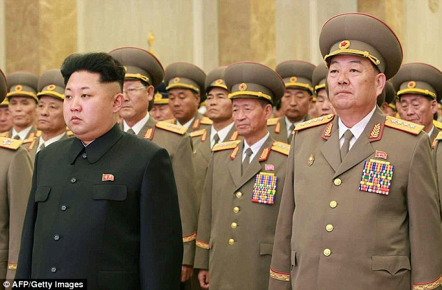 Sick: Hyon Yong-Chol (right), who was named Minister of the People's Armed Forces in 2012, had been charged with of disloyalty and disrespect towards North Korea's leader Kim Jong-un (left)