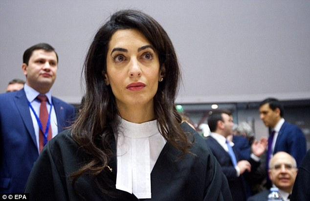 George Clooney's barrister wife Amal (pictured) gave the Greek government a 150-page report urging them to take Britain to the International Criminal Court for the return of the 5th century BC sculptures two days ago