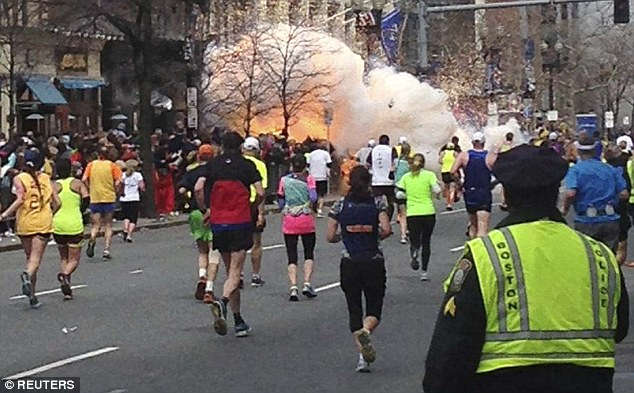 Destruction: One of the two explosions at the marathon is pictured above. Three people died from the bombs and hundreds were injured