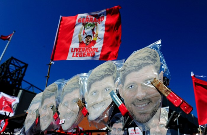Heroic: Gerrard masks were for sale as well as flags outside of Anfield as the club's fans waved their hero off in style