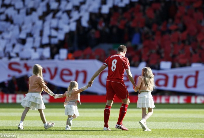 Leader: Liverpool's legendary captain Gerrard steps on the Anfield turf with his three daughters,Lilly-Ella 11, Lexie, nine, and Lourdes, three