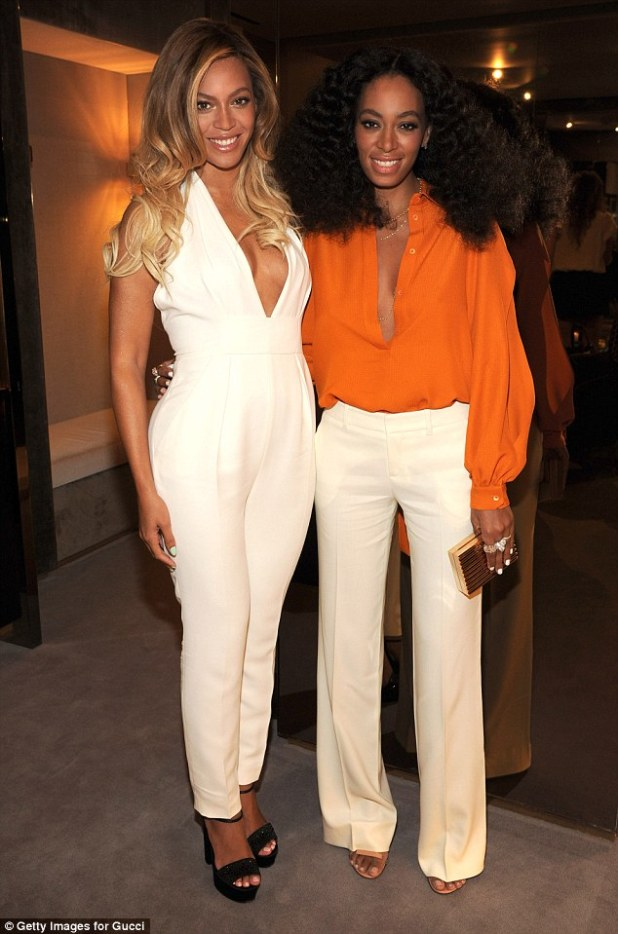 Sister act: Solange made her way to catch a flight to NYC - where her sister Beyonce lives with husband Jay Z; seen above, the sisters posed at an event last year