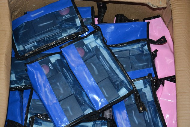 In one shipping container police found more than 4,700 counterfeit versions of MAC products including foundation, bronzer, lip gloss and eye shadow. They are shoved into the boxes like this (pictured)