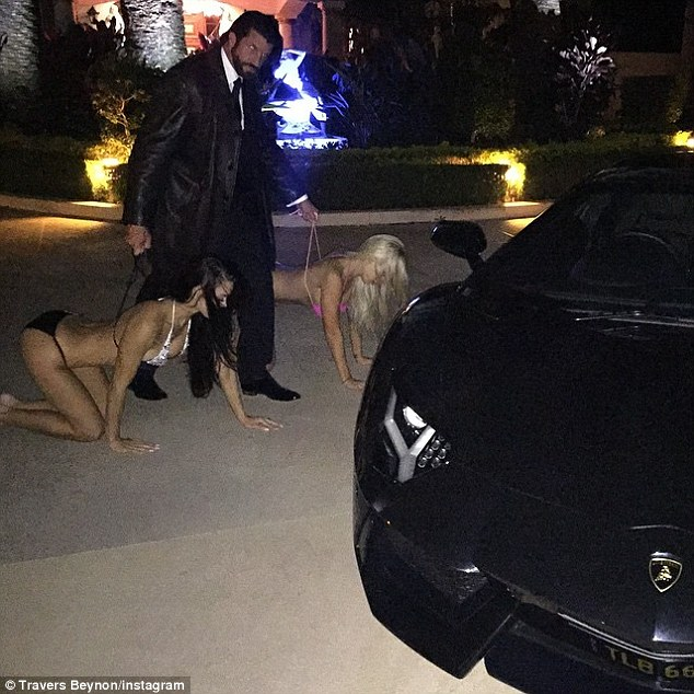 """On a leash: An image posted on The Candyman's Instagram shows his wife on her hands and knees being walked around. It was captioned 'Candyman's interpretation of """"Doggy Style""""'"""