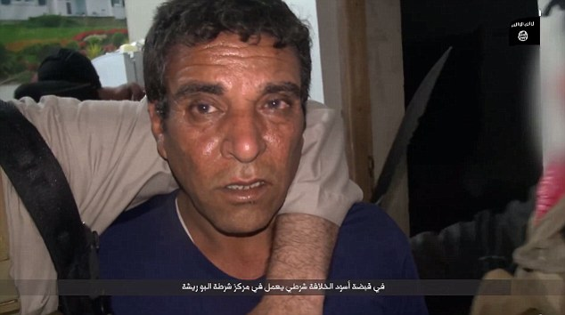Horror: An Iraqi man captured by ISIS during their siege on Ramadi looks terrified in one of their propaganda videos - in which he is later seen decapitated