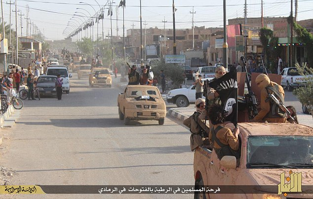 Moving on: The ISIS militants who are celebrating battlefield success in Ramadi could soon march to Iraq's capital Baghdad just 60 miles east, experts claim