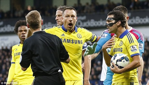 Chelsea captain John Terry looks shocked after Jones produces the red card for Fabregas in the first half