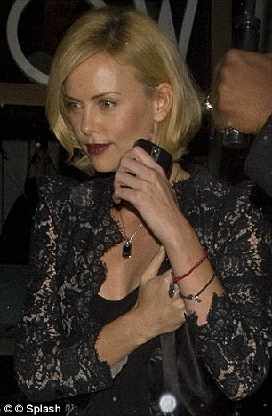 Devotee: Actress Charlize Theron, wearing the group's signature bracelet
