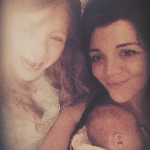 Ms Bruce, 27, pictured with Chloe, now a month old and elder daughter Brooke, seven,  went into hospital  five days before her due date because she had noticed her unborn baby's movements slow down