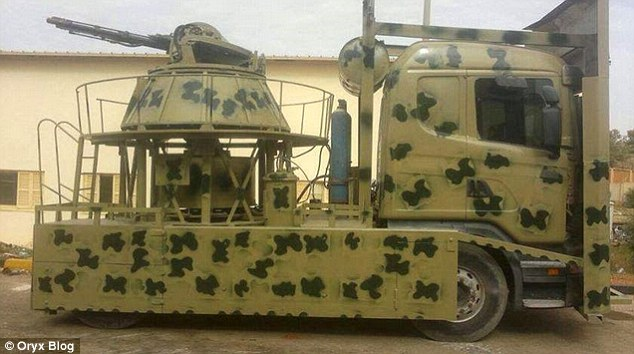 Surreal: The Libyan army - which has mounted machine gun turrets on trucks to take on ISIS and opposition factions - is running out of scraps to replenish its makeshift armoury