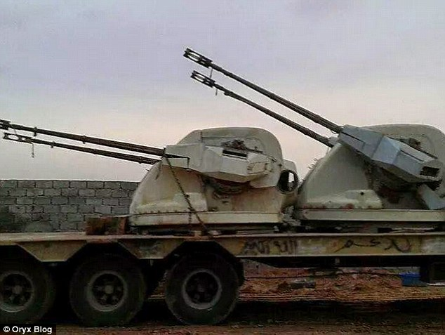 Salvaged: Oryx claims that Libya Dawn equips its vehicles with  a double-barreled 35mm naval gun (pictured) taken from the British-built frigate which was scrapped in the 1990s