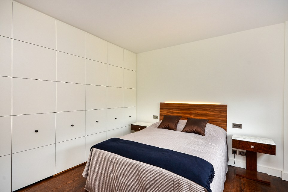 The second bedroom in the £1million flat has been decked out in almost identical furnishings to the next door flat, owned by the same person