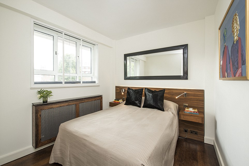 Fancy: The third-floor flats (pictured is the £1million flat) have two bedrooms with a wood theme andhand-crafted chevron flooring throughout