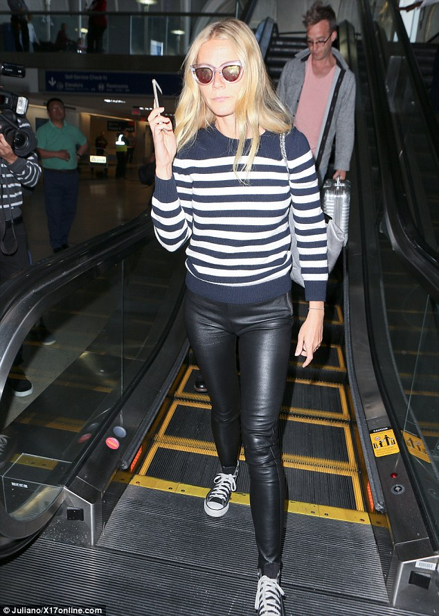 Gwyneth Paltrow is leggy in leather trousers as she recycles same sweater and accessories worn