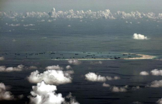 Aerial photograph taken from a military aircraft on May 11, 2015 shows alleged on-going reclamation by China on Mischief Reef in the Spratly group of islands in the South China Sea