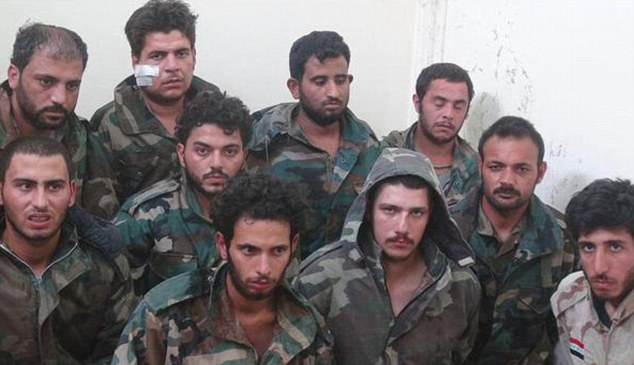 Captured: Syrian soldiers that were taken after ISIS took control of the ancient city of Palmyra