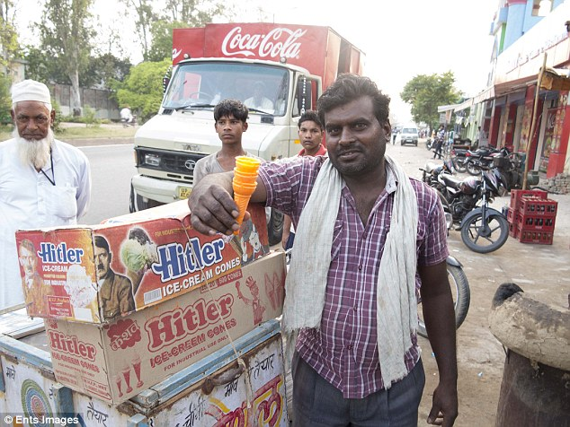 Not so sweet treat: A street-seller stands with his boxes of Hitler cones. Hitler's name and image are splashed across the boxes of ice cream cones, which are readily-available across India