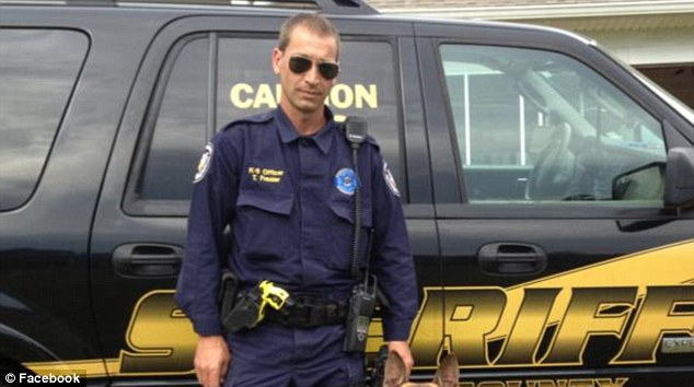 Attacked: Deputy Todd Frazier (above) of Long Beach, Mississippi, pulled over last Monday night to check on a car with the driver passed out in the front seat and was suddenly dragged off into the woods to be killed
