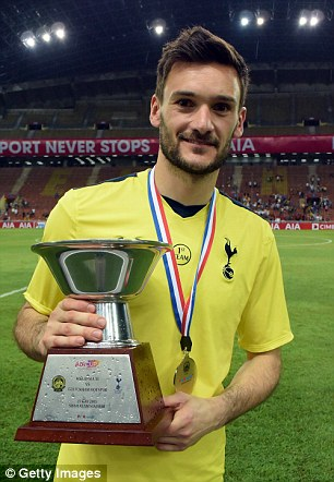 Hugo Lloris, who is linked with a move away, holds the AIA Cup