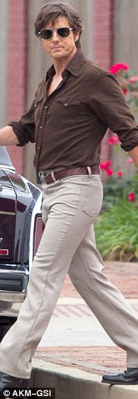 Pick a color, any color: Tom Cruise was styled in a rainbow of colors on set of his latest film in Ball Ground, Georgia on Wednesday
