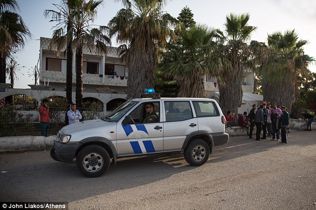 The coastguard patrols the area where migrants are living temporarily in the abandoned Captain Elias Hotel