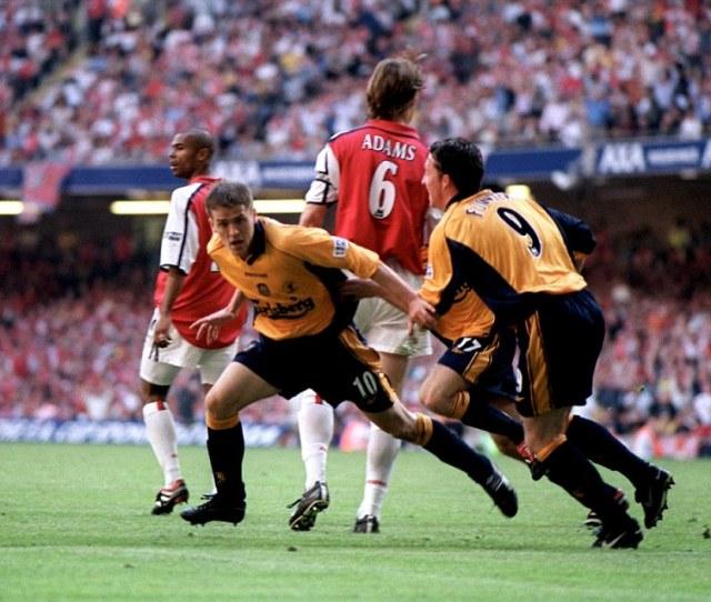Liverpool Striker Michael Owen Left Celebrates Scoring Twice As Arsenal Were Beaten